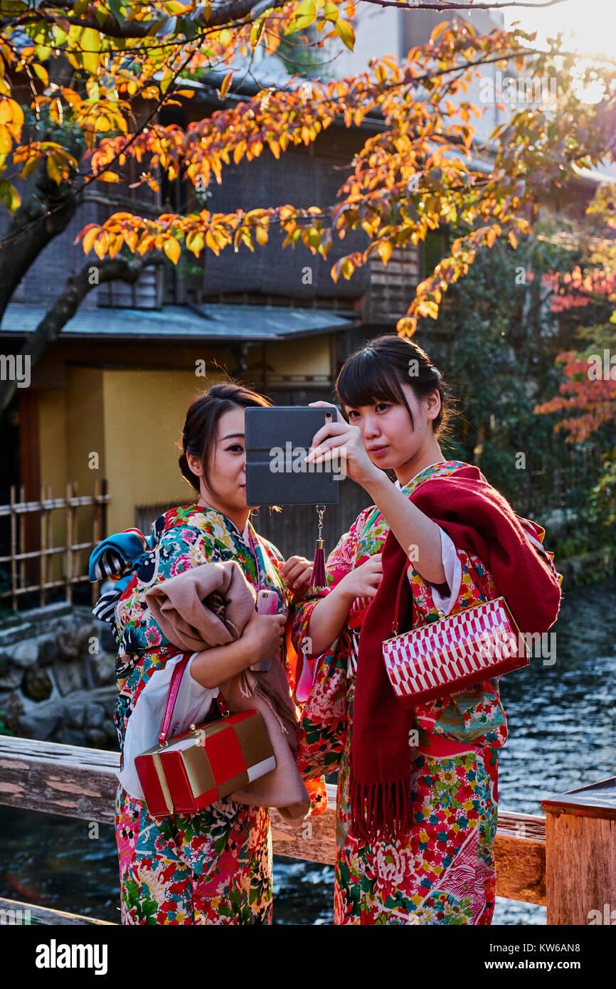 Japan, Honshu island, Kansai region, Kyoto, Gion, Geisha former area, young women in kimono Stock Photo