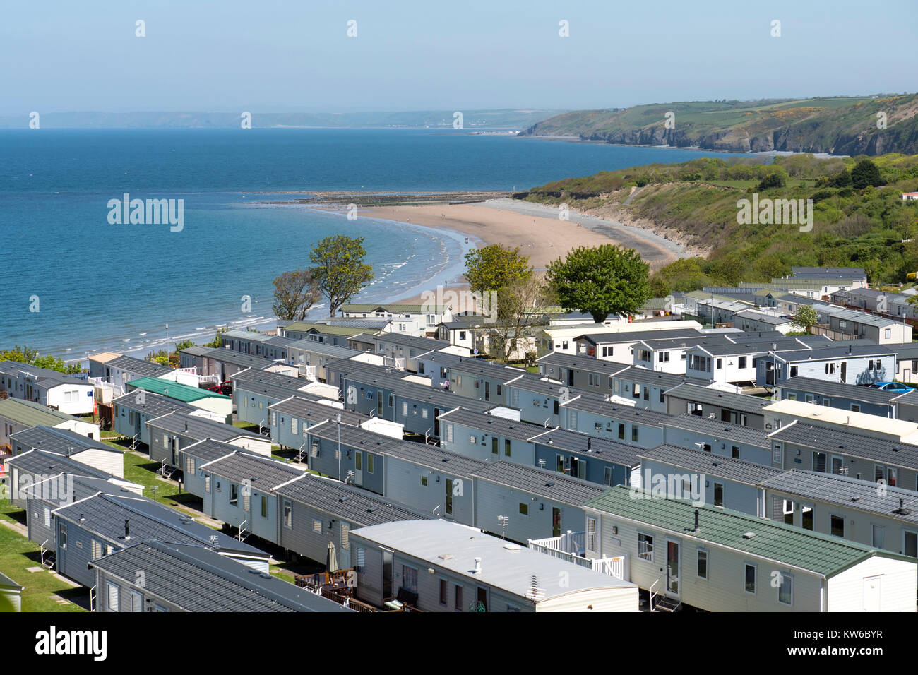 Holiday caravan park and coast line New Quay Ceredigion Wales - Stock Image