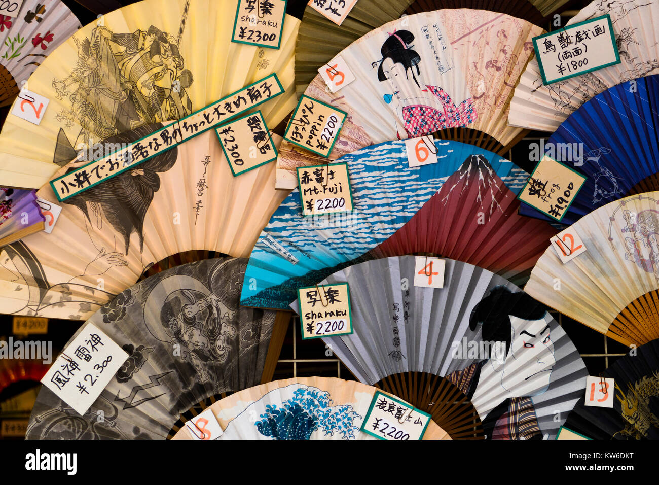 Tokyo - Japan, June 19, 2017:  Shop window with traditional colorful hand fans and price tags - Stock Image