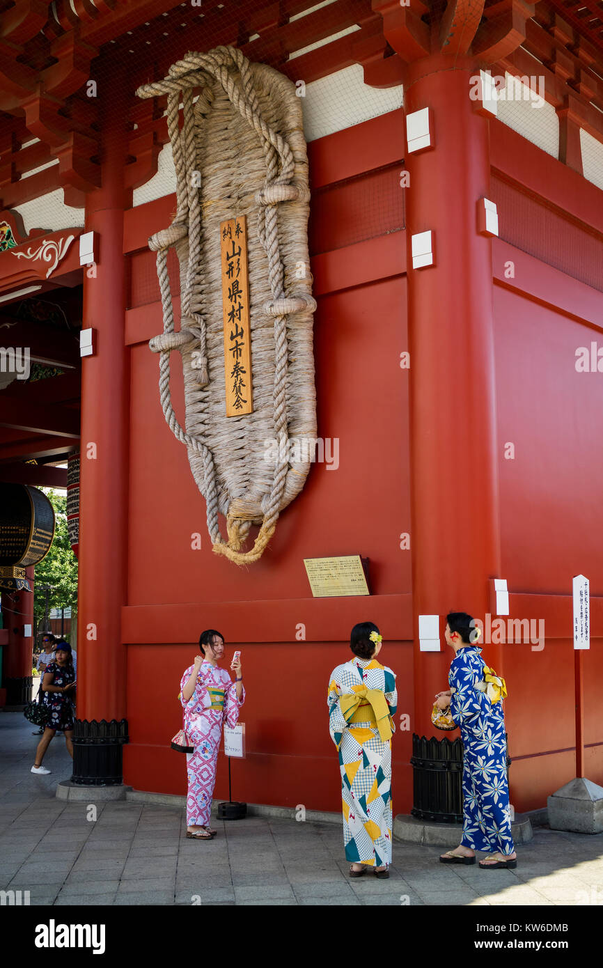 Tokyo - Japan, June 19, 2017; Tourists at Edo era Hozomon entrance of Sensoji, also known as Asakusa Kannon Temple, - Stock Image