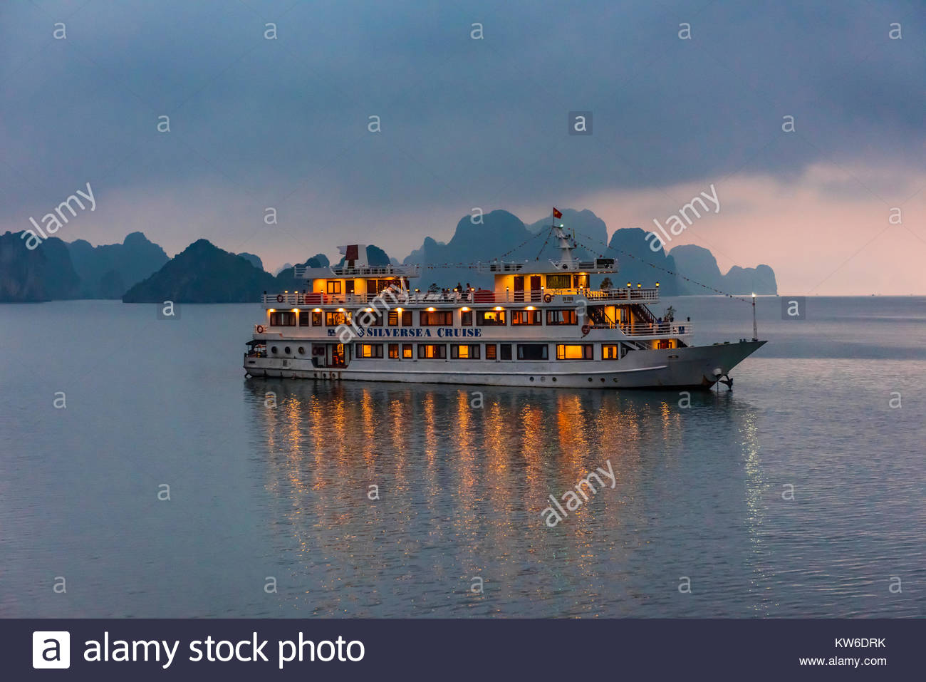 Ships anchored for the night in Halong Bay, North Vietnam. The bay features 3,000  limestone and dolomite karsts - Stock Image