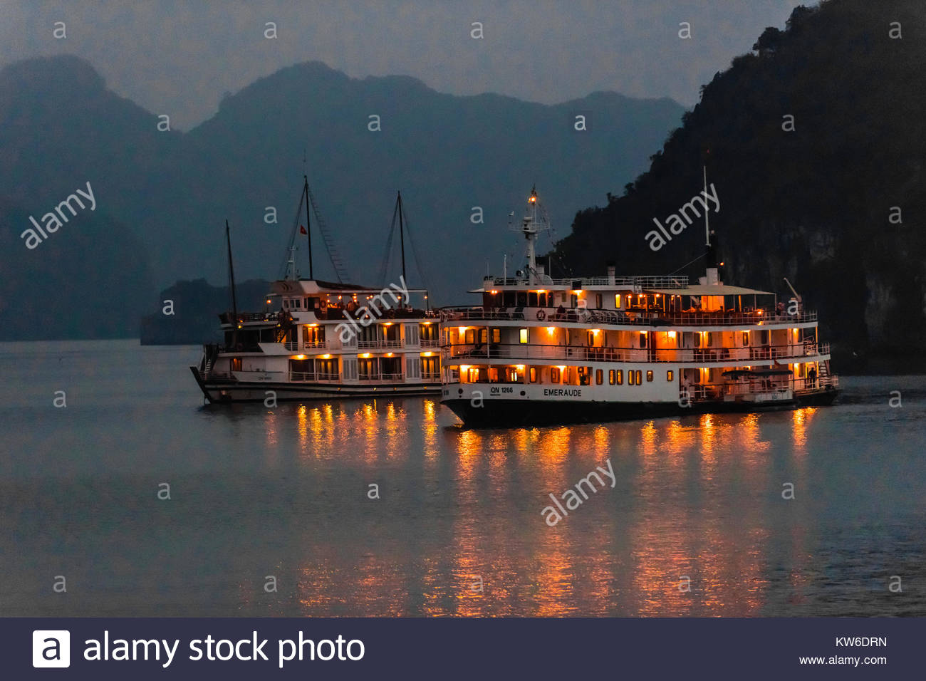 Ships anchored for the night in Halong Bay, North Vietnam. The bay features 3,000  limestone and dolomite karsts Stock Photo
