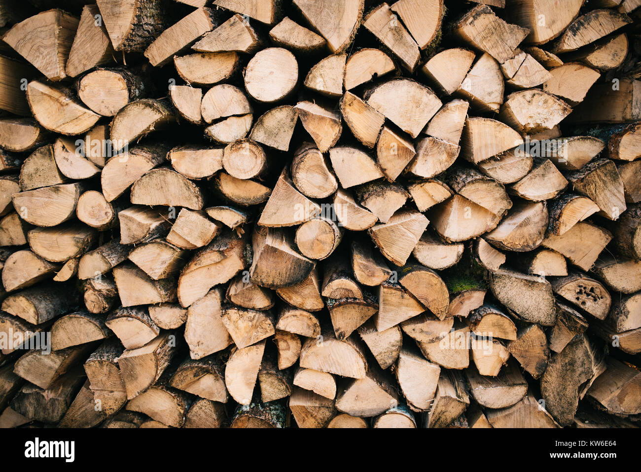 Stacked firewood background - Stock Image