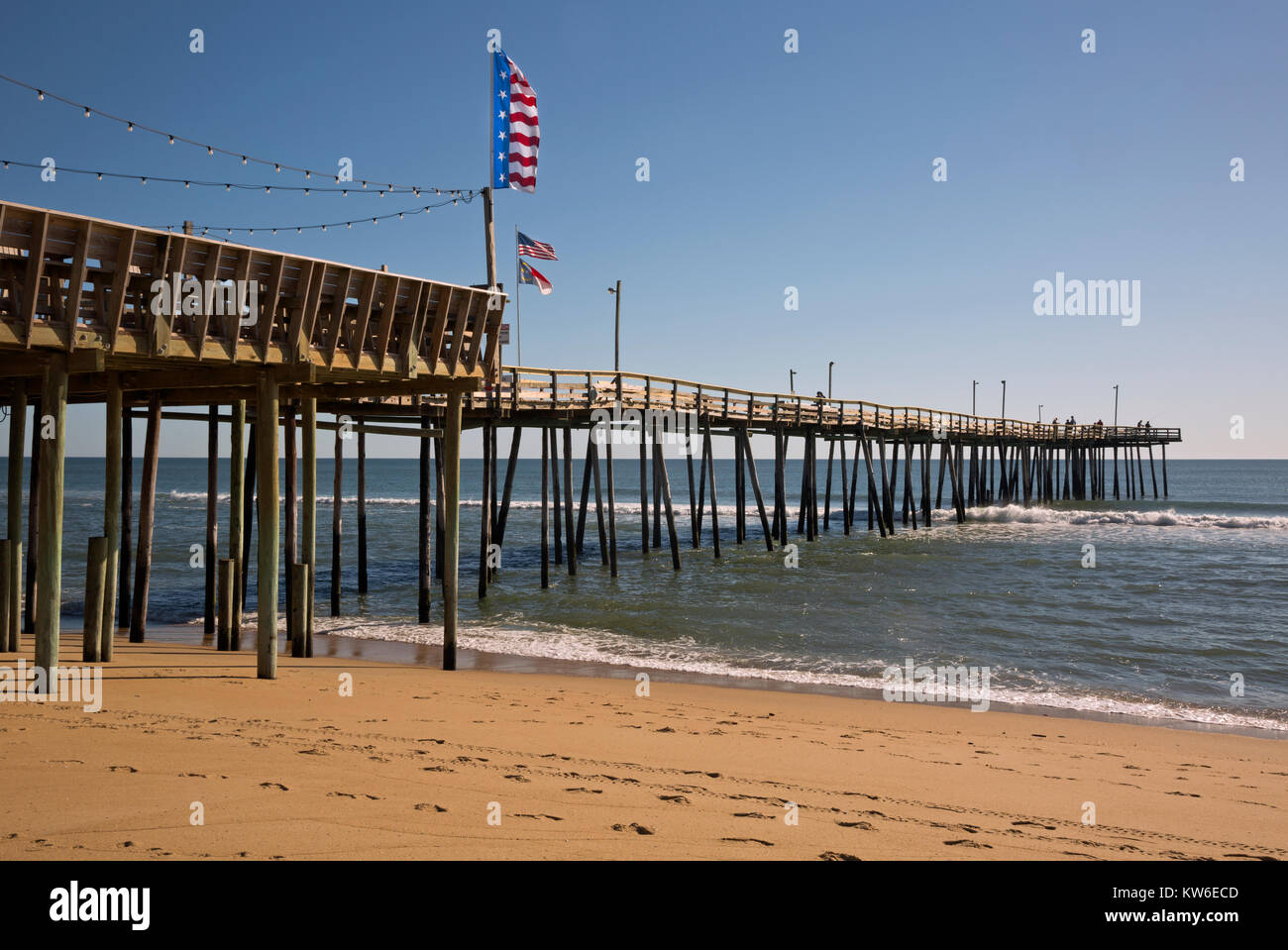 NC01190-00...NORTH CAROLINA - Flags flying on the Outer Banks Fishing Pier, located on the Atlantic Ocean in South Stock Photo