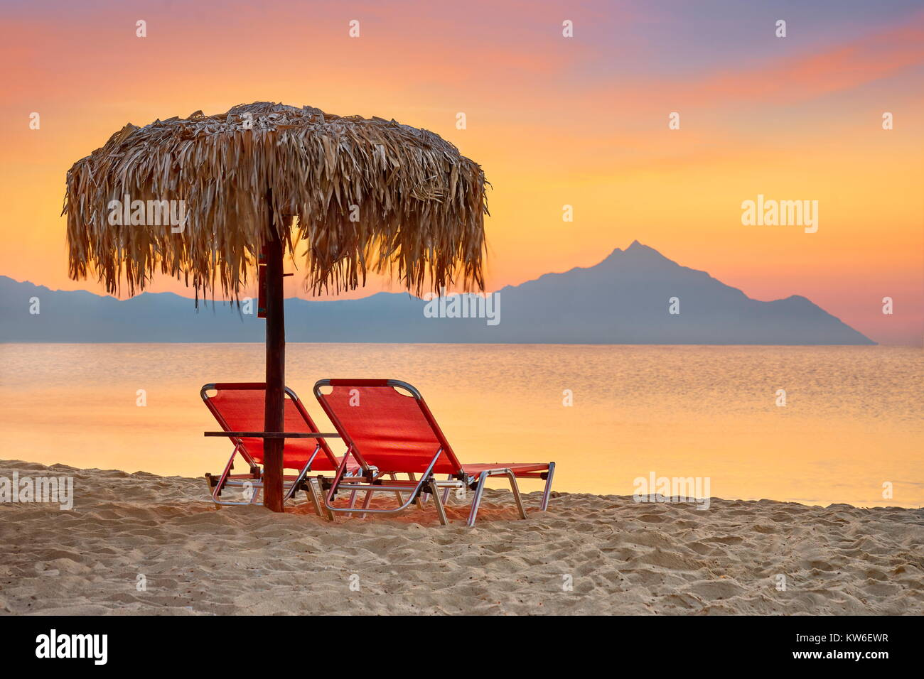 Halkidiki (or Chalkidiki) beach before sunrise, Mount Athos in the background, Greece - Stock Image