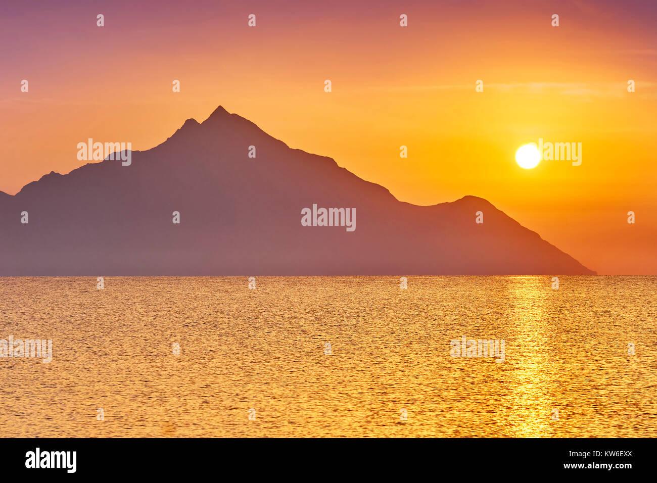 Sunrise over Mount Athos, Halkidiki or Chalkidiki, Greece - Stock Image