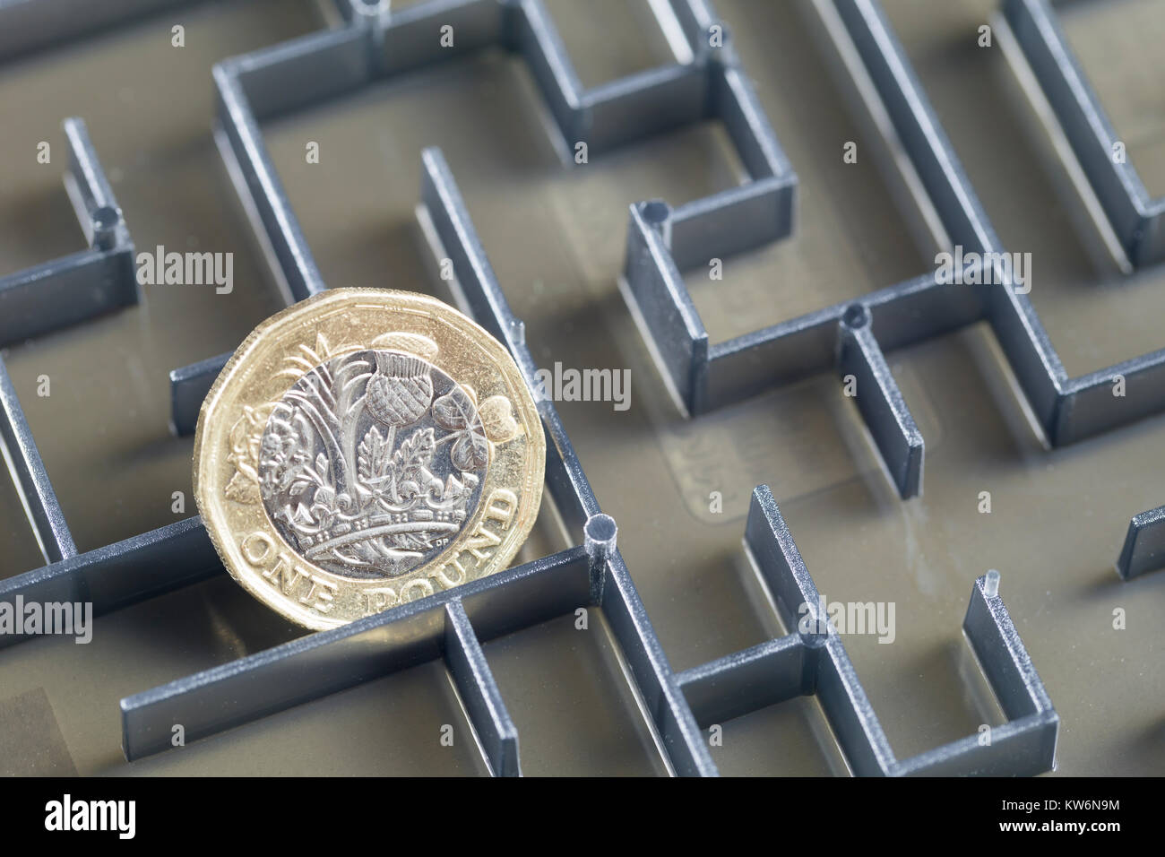 Pound coin in a maze - Stock Image