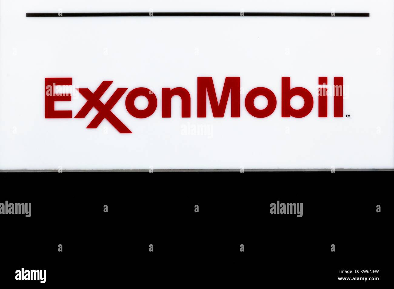 Hamburg, Germany - July 21, 2017: Exxon Mobil logo on a wall. Exxon Mobil Corporation is an American multinational - Stock Image