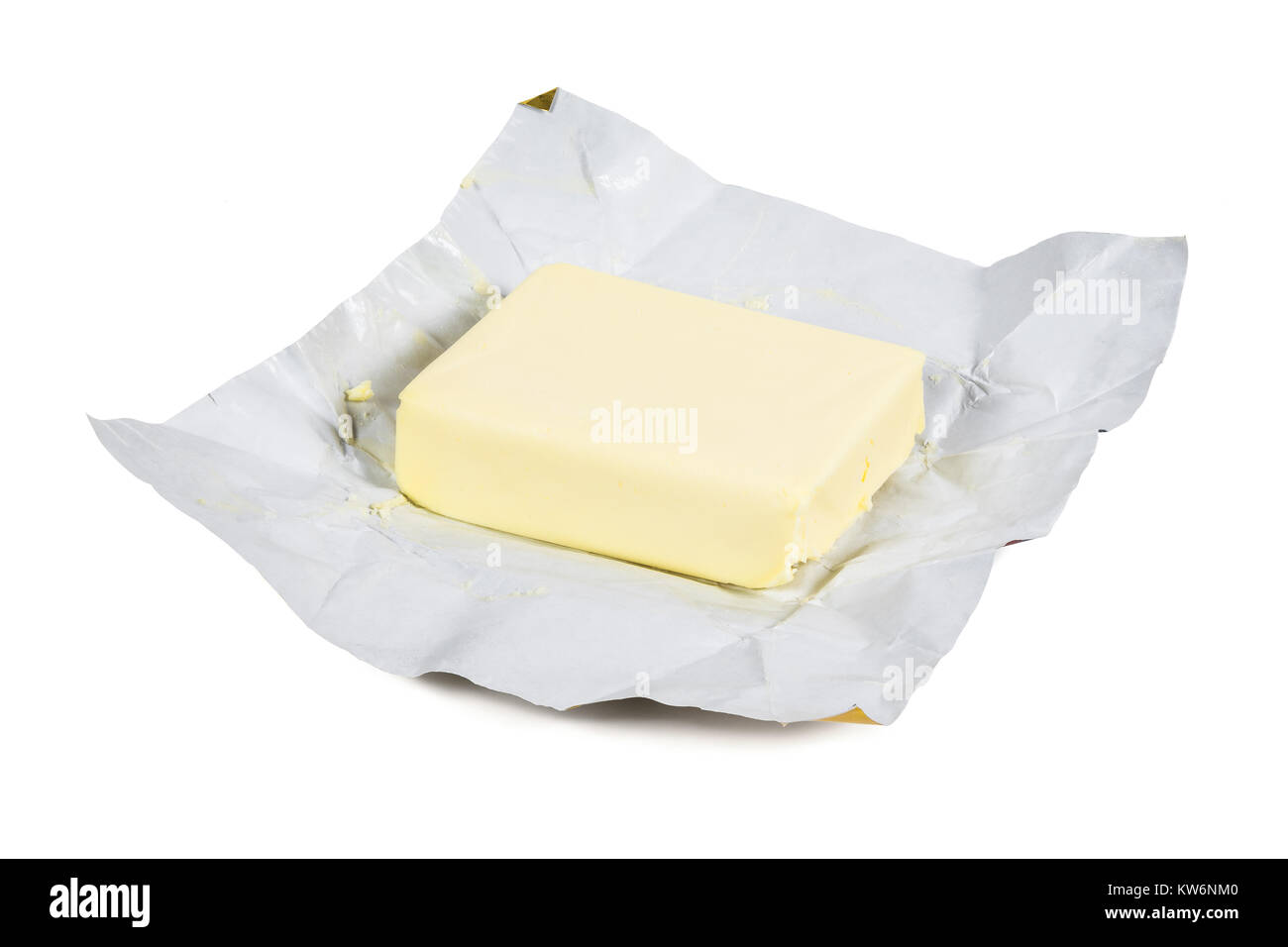 Piece of fresh butter isolated on white background with clipping path - Stock Image