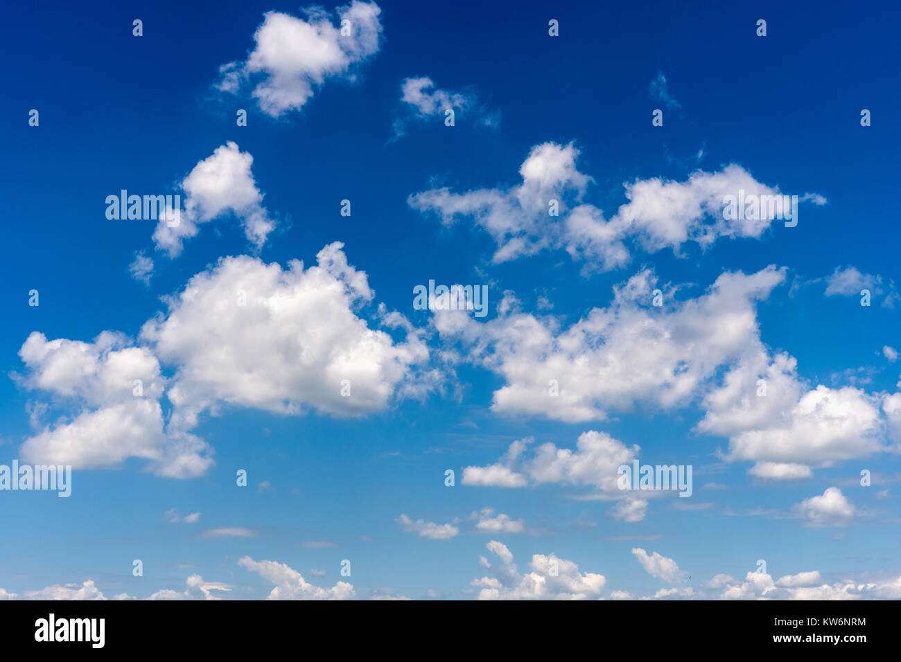 Weather condition with fluffy clouds in the blue sky - Stock Image
