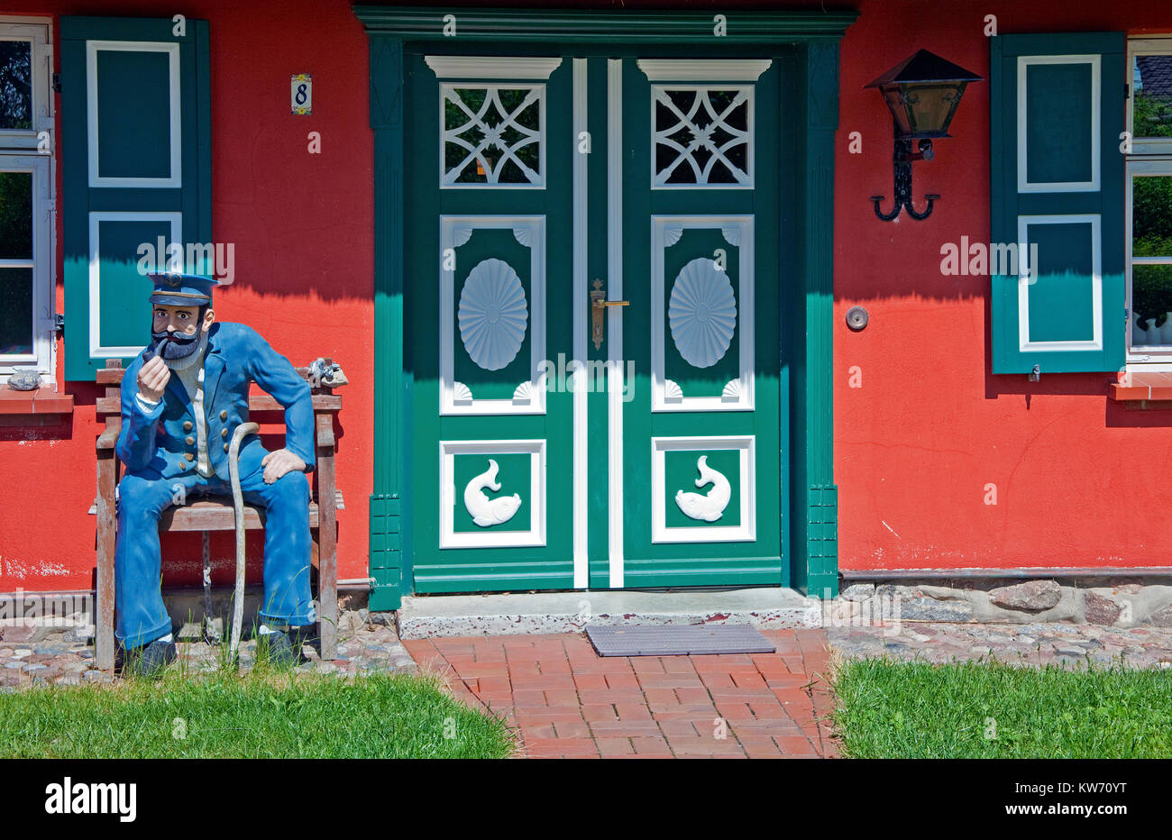 Captain figure in front of a colourful house, village Althagen, Ahrenshoop, Fischland, Mecklenburg-Western Pomerania, - Stock Image