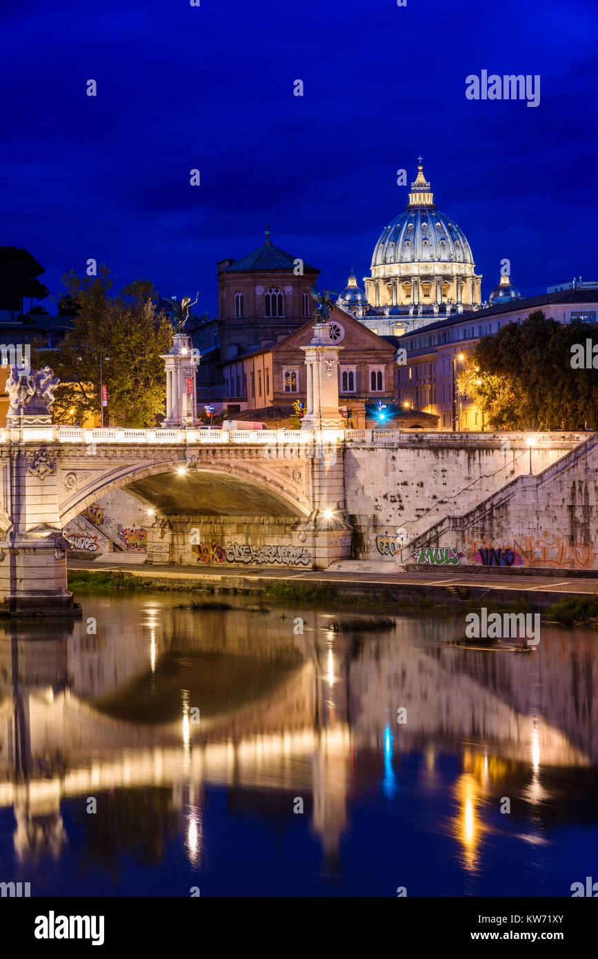 Night view of Tiber river with Saint Peter's Basilica on the background, Rome, Lazio, Italy - Stock Image