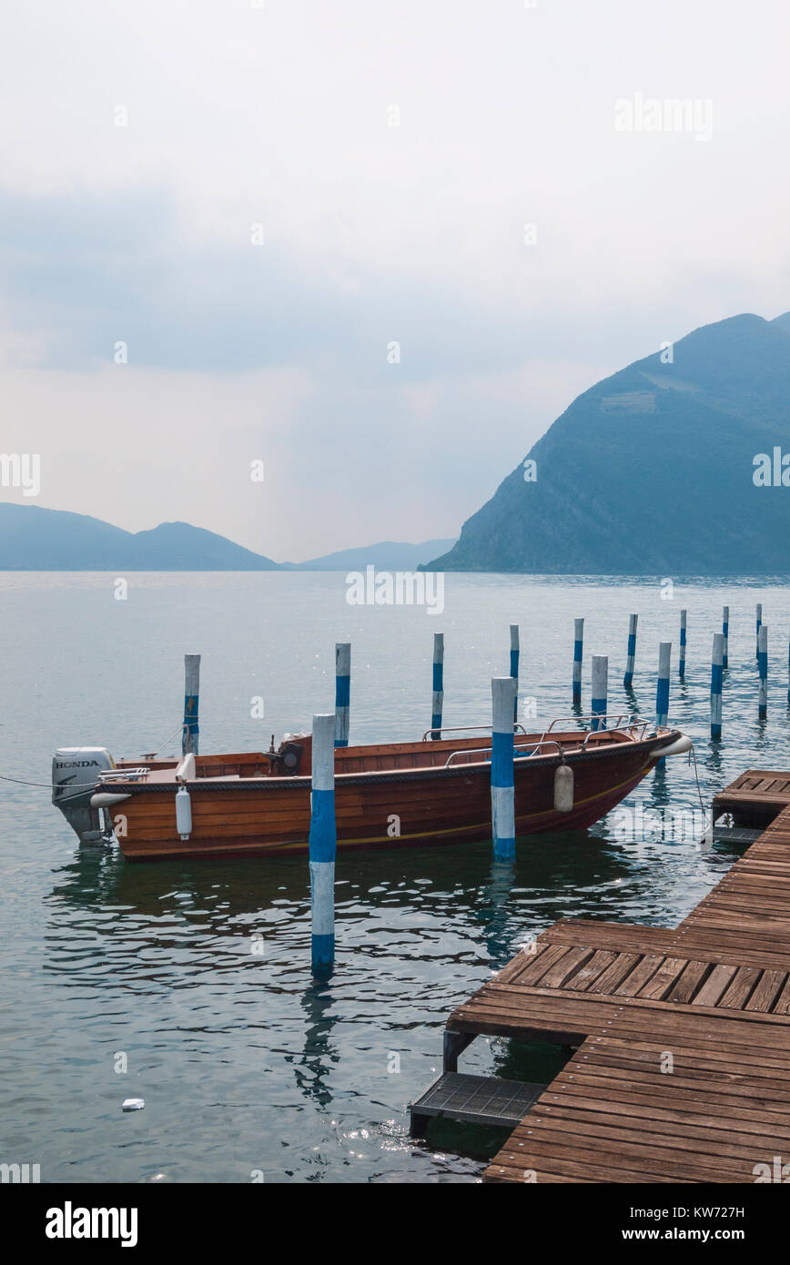 A boat moored to a dock at Monte Iseo in Italy - Stock Image