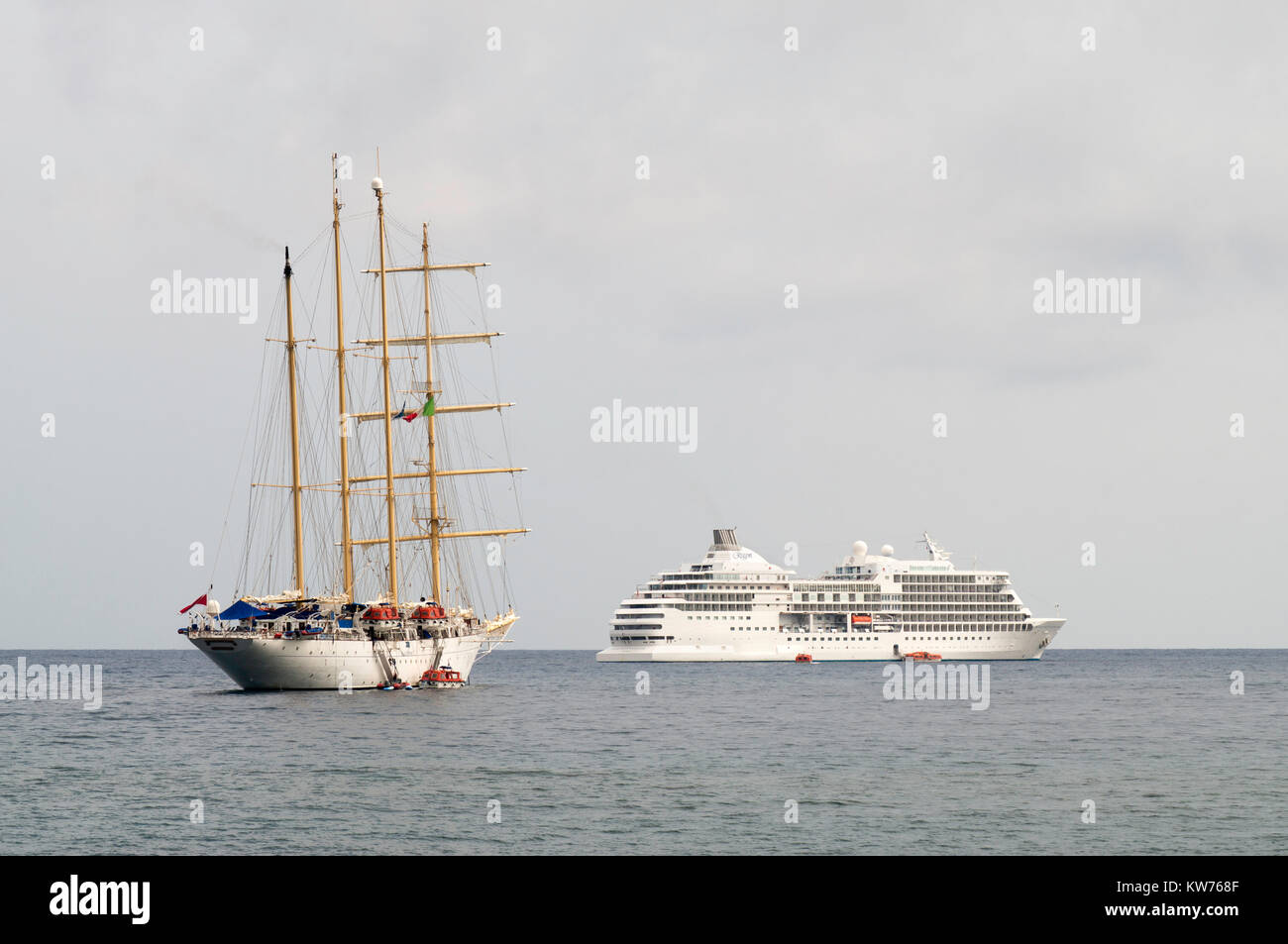 Star Clippers four masted barquentine and Seven Seas Navigator lying off Giardini Naxos, Sicily, Europe - Stock Image