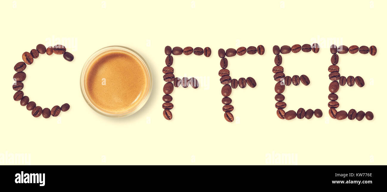 Top view of word coffee made from coffee beans and glass cup of hot coffee Stock Photo