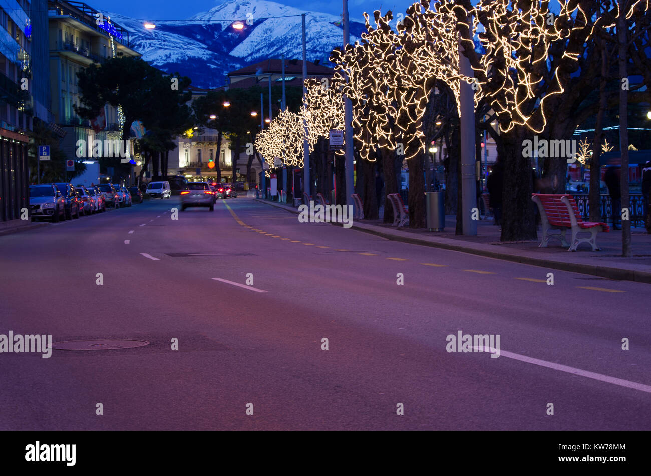 row of trees decorated for the Christmas period in Lugano, Switzerland Stock Photo