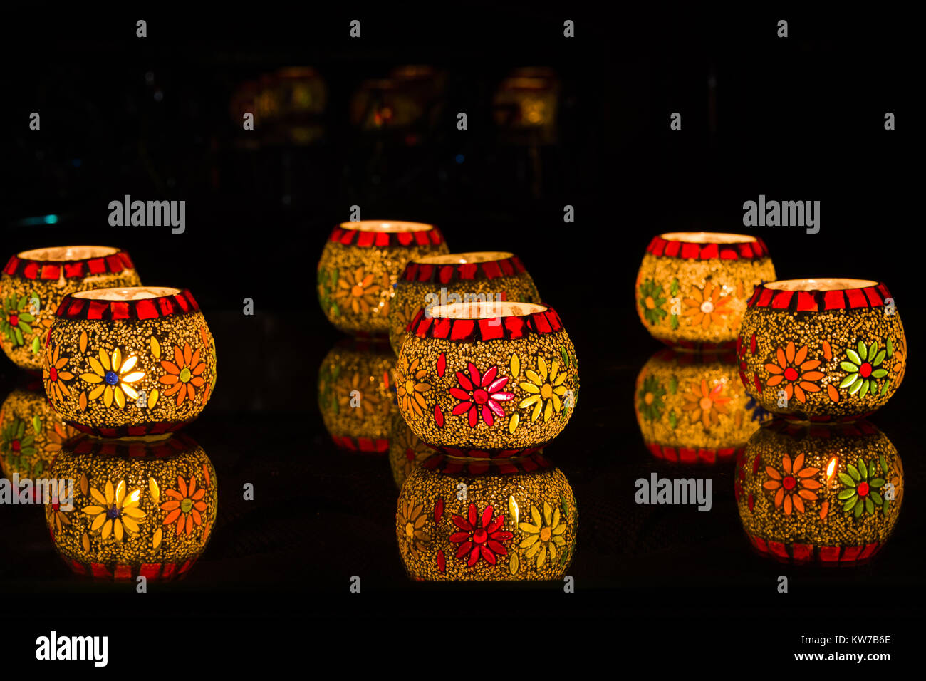 Illuminated Colorful candle votive at Diwali celebrations - Stock Image