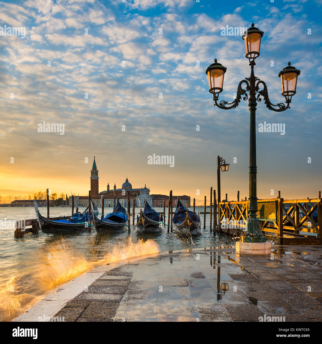 Gondolas on the Grand Canal at sunrise in Venice, Italy - Stock Image