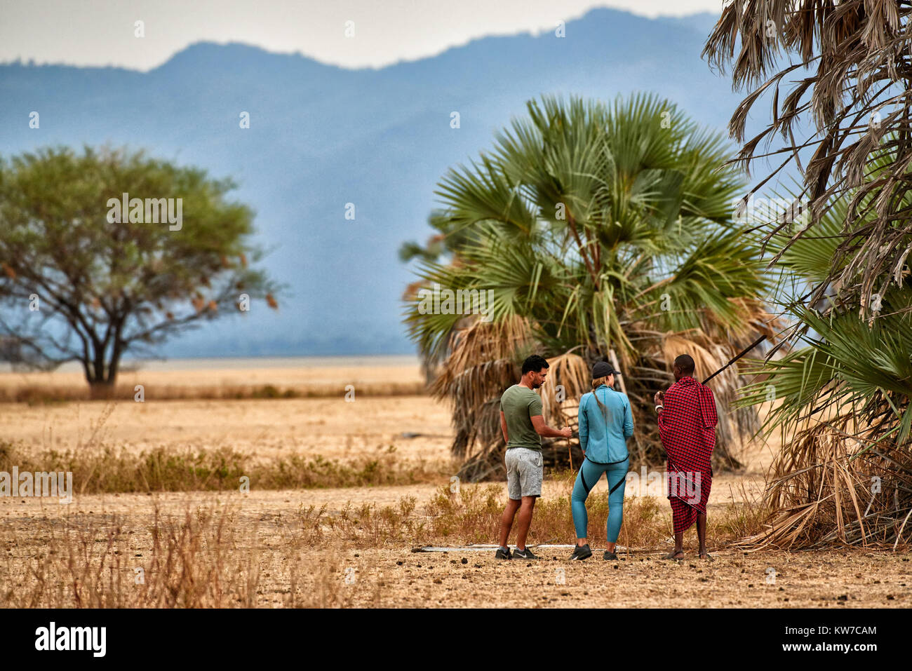 walking safari with Masai, Lake Manyara National Park, Tanzania, Africa - Stock Image