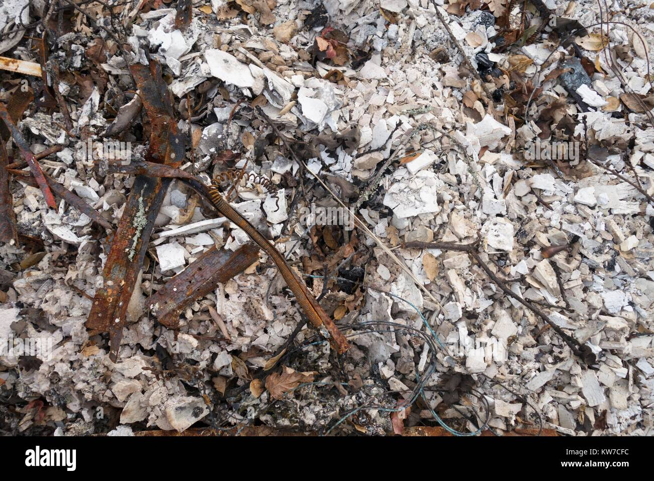 A pile of ash and rubble from a house, among the damage from the Tubbs wildfire in Santa Rosa, California, USA. Stock Photo