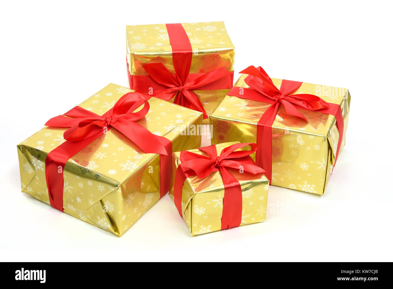 Concept of luxury Christmas gifts - boxes packed in golden paper and ...