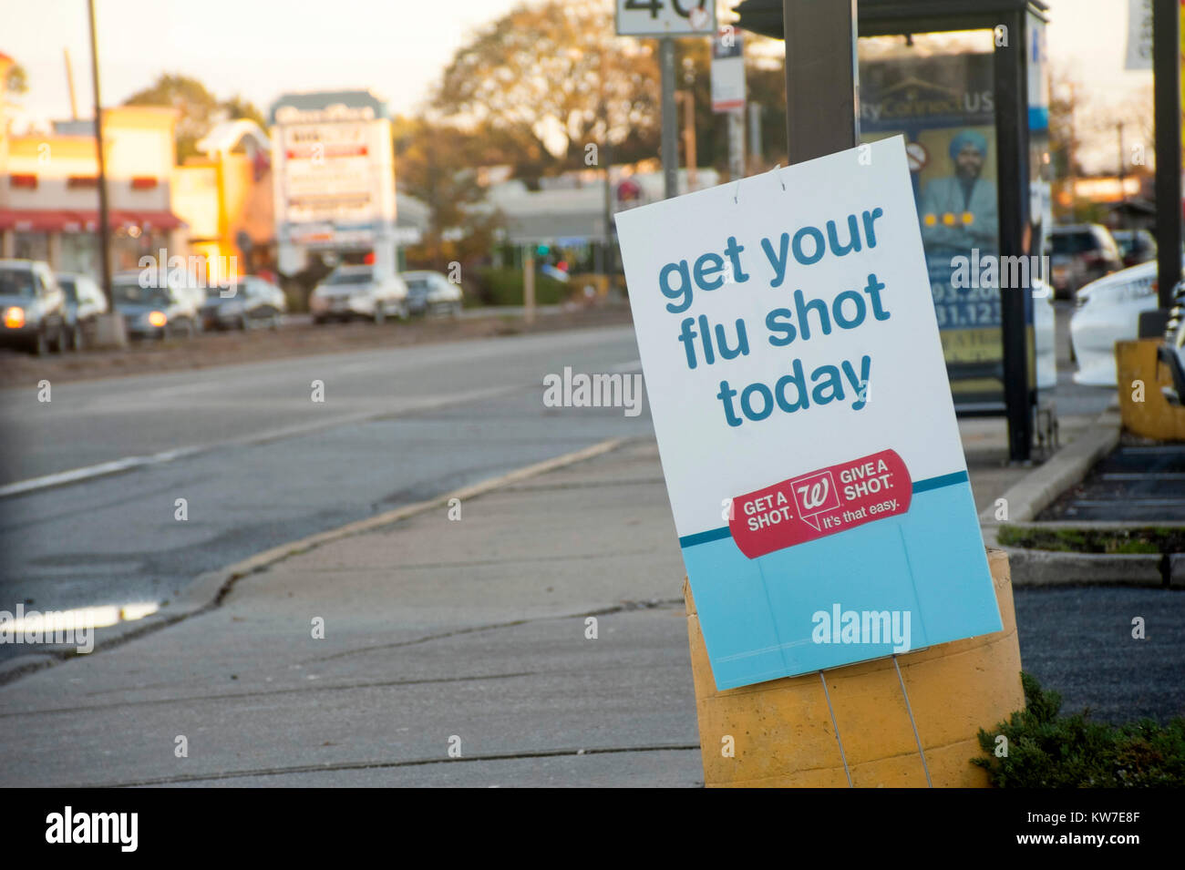 Street banner advertising where to get flu shots - Stock Image