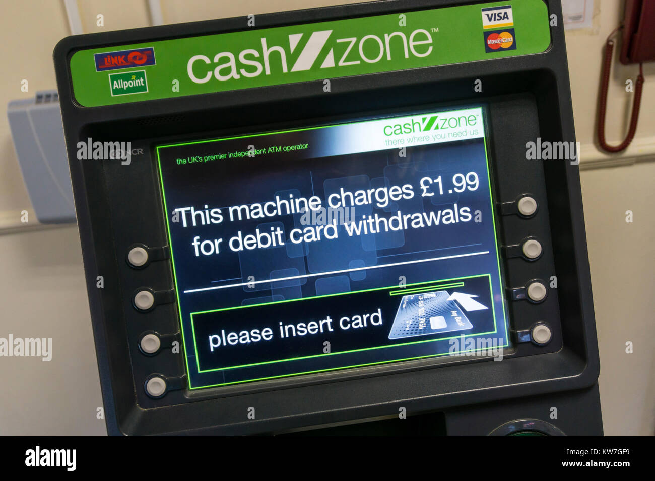 A CashZone ATM in a motorway service station warns that there is a £1.99 charge for cash withdrawals by debit - Stock Image