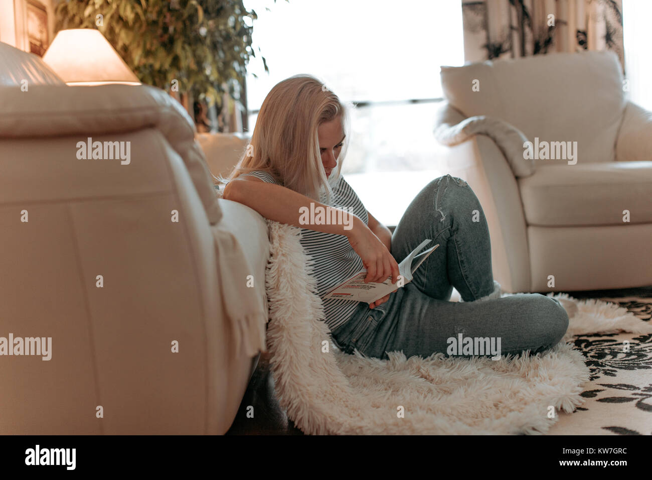 Beautiful Young Blonde Female Student Studying Or Reading A Stock