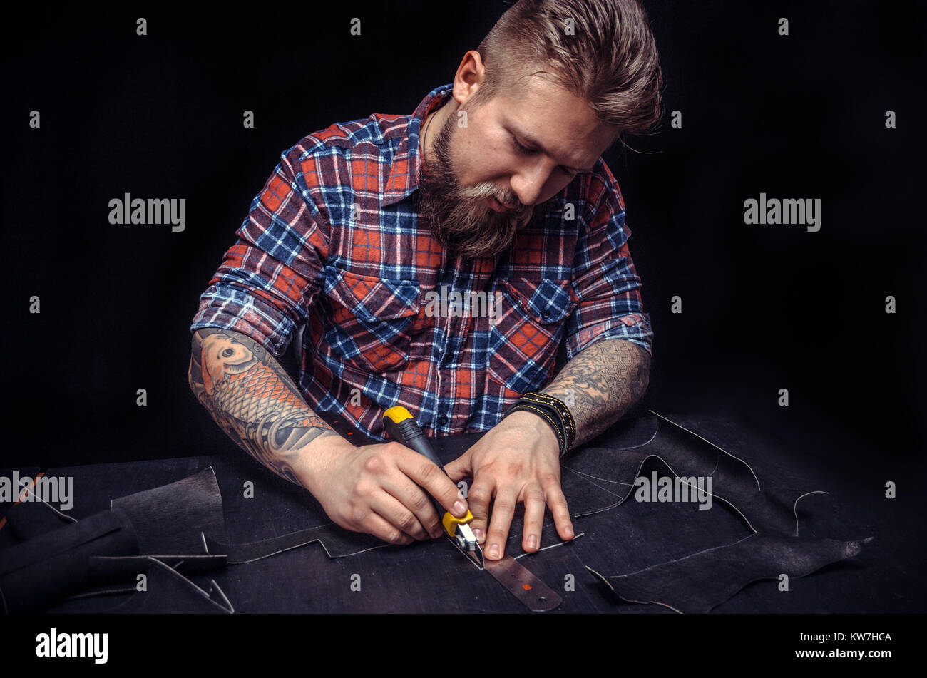 Leather workman focusing on his work  Stock Photo