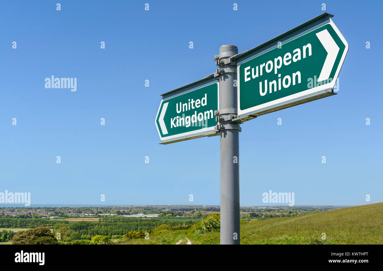 UK one way and EU the other concept sign. European Union and United Kingdom signpost. Brexit concept. - Stock Image