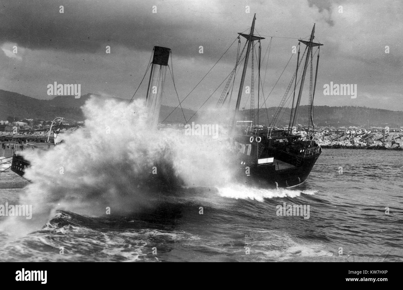 Waves breaking up the Opouri, which was washed onto the north breakwater after her steering gear failed at Greymouth, - Stock Image