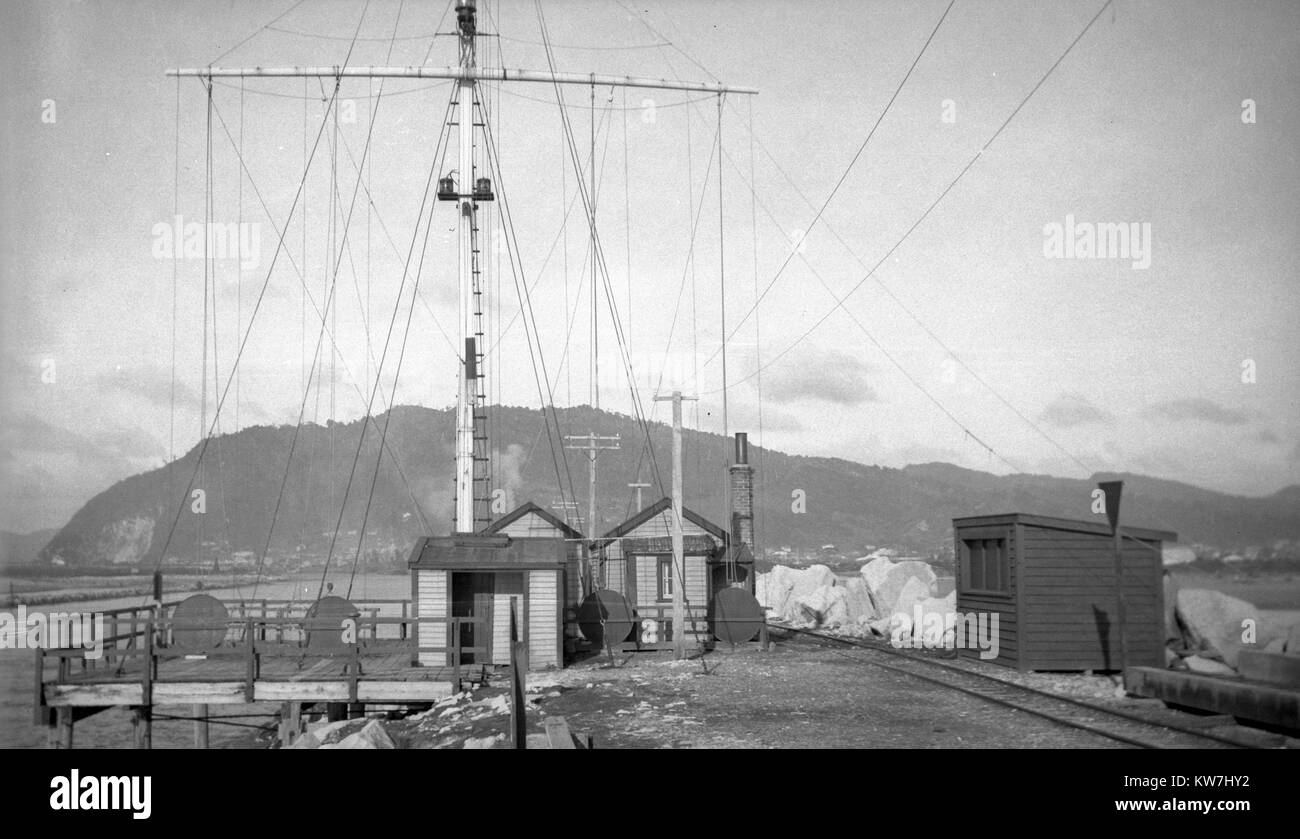 Completed masts and buildings on the North Tiphead, Greymouth Port, Westland, New Zealand, probably in the 1930s. - Stock Image