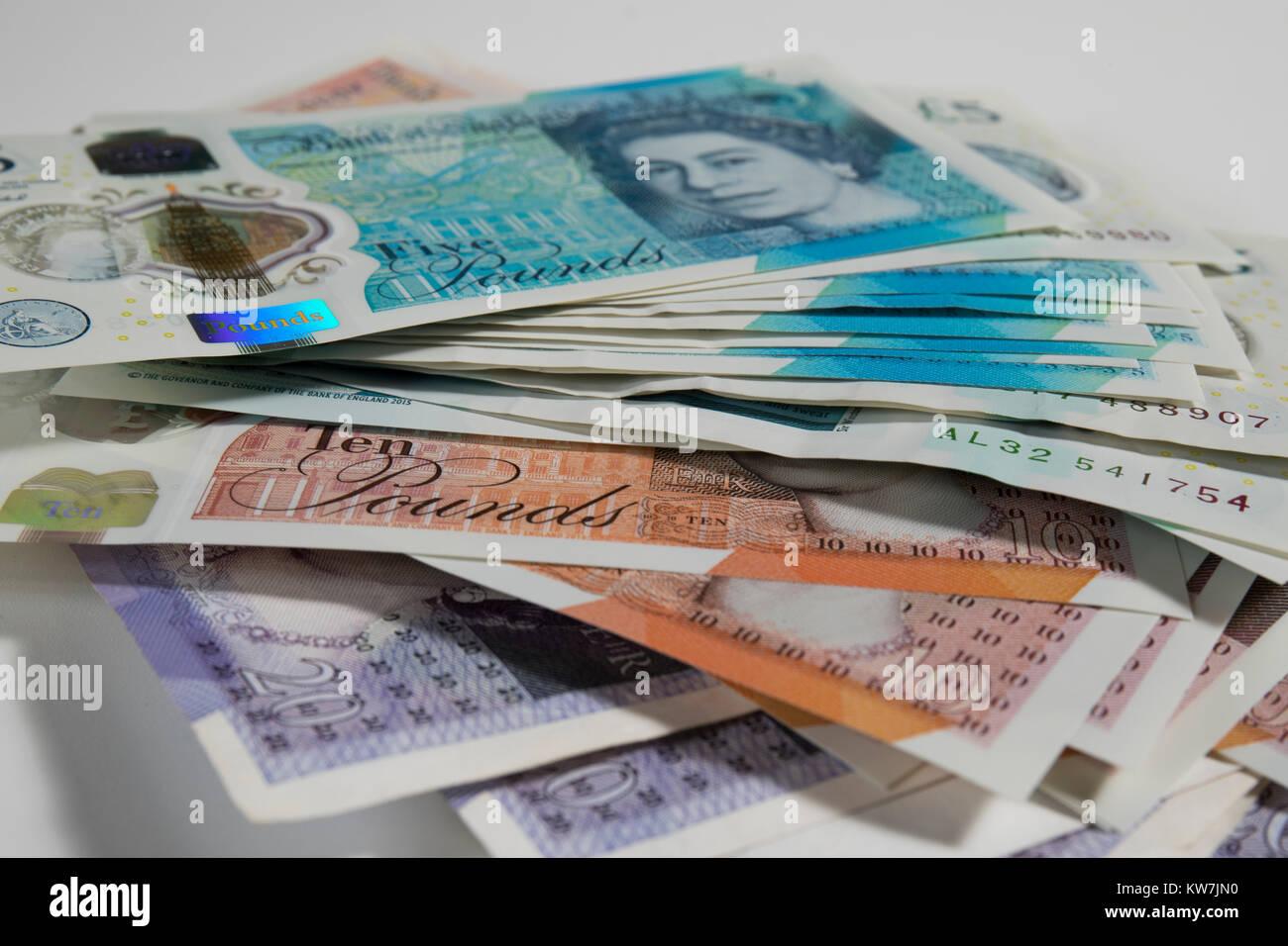 5, 10 and 20 Pound notes randomly arranged. - Stock Image
