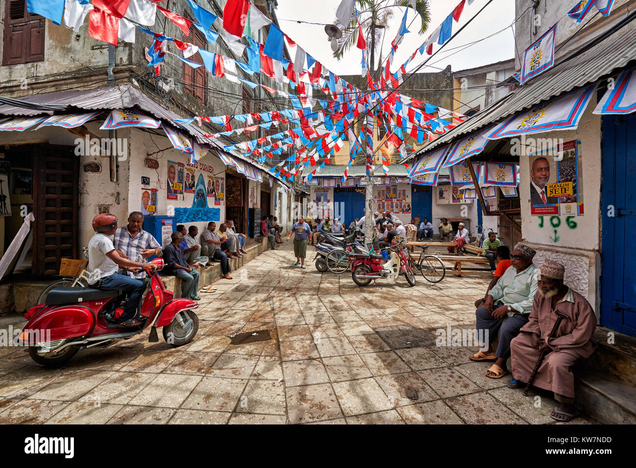 colorful flags for elections at street scene with typical buildings in Stone Town, UNESCO World Heritage Site, Zanzibar, - Stock Image