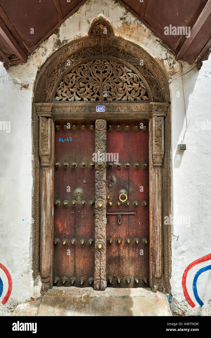 typical arabic styled doors with carved doorframe in Stone Town, UNESCO World Heritage Site, Zanzibar, Tanzania, - Stock Image