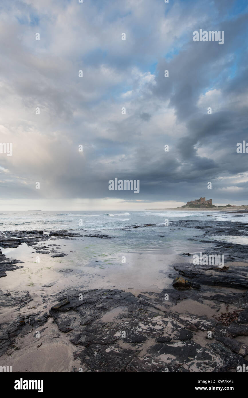 Bamburgh Castle in the late evening sunlight at sunset - Stock Image