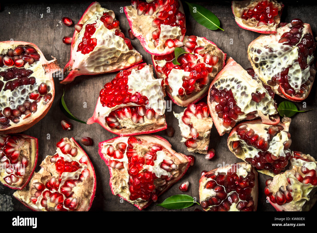 Fresh pomegranates on a wooden tray. Top view - Stock Image