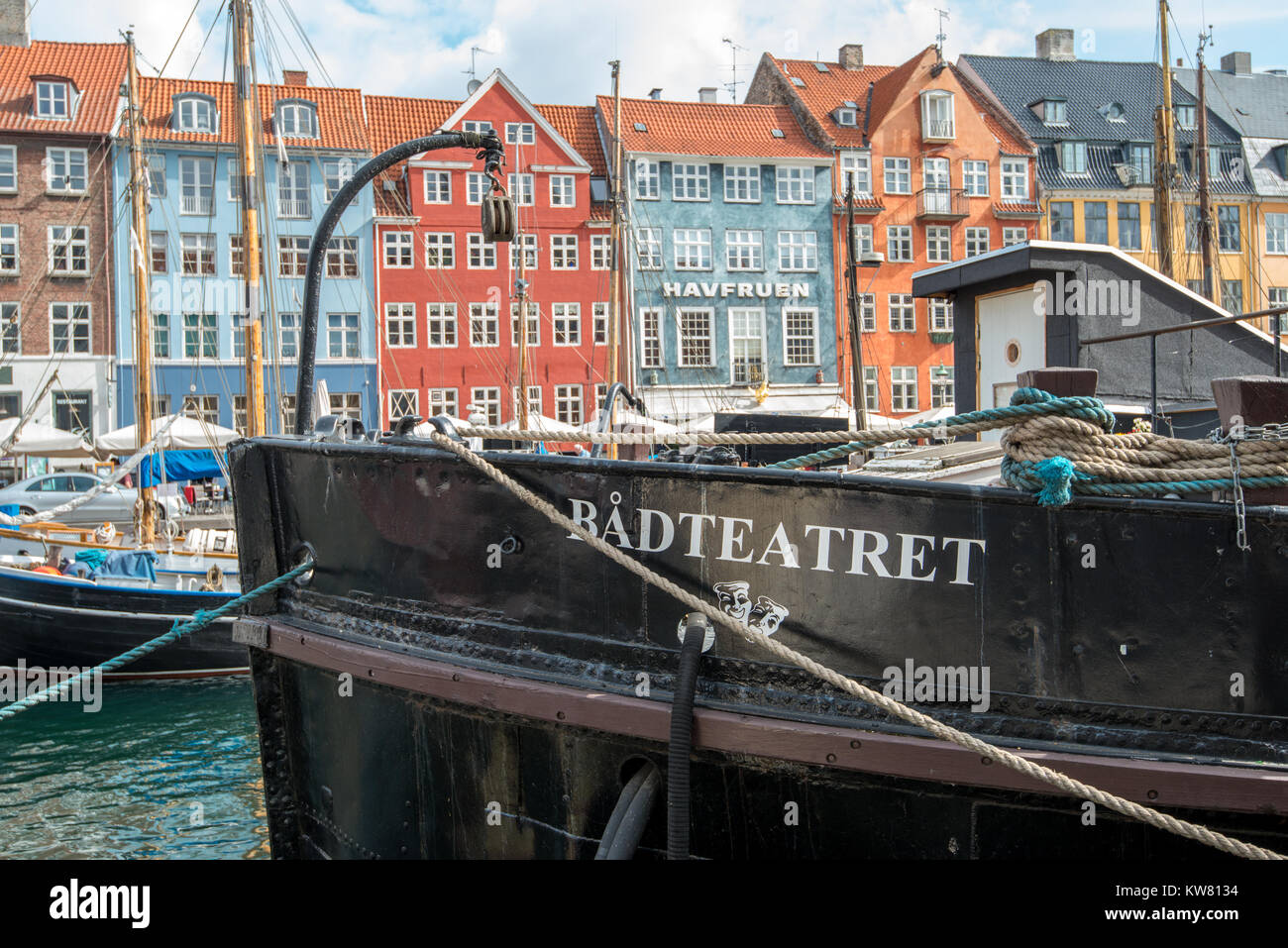 Boat theater at Nyhavn, a 17th century harbor district in Copenhagen and a popular waterfront tourist attraction - Stock Image