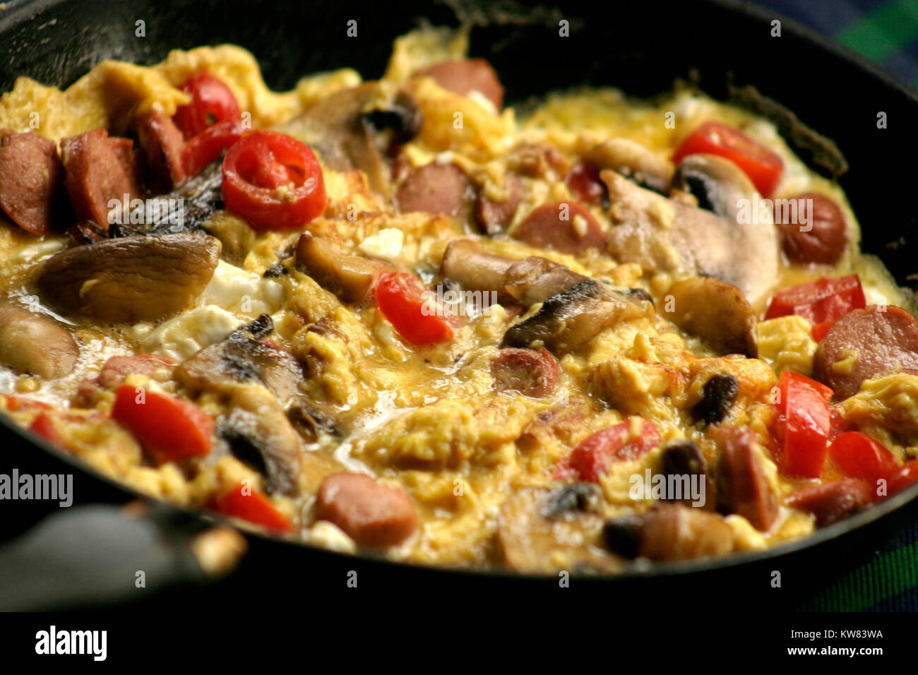 Close-up of omelet with vegetables - Stock Image