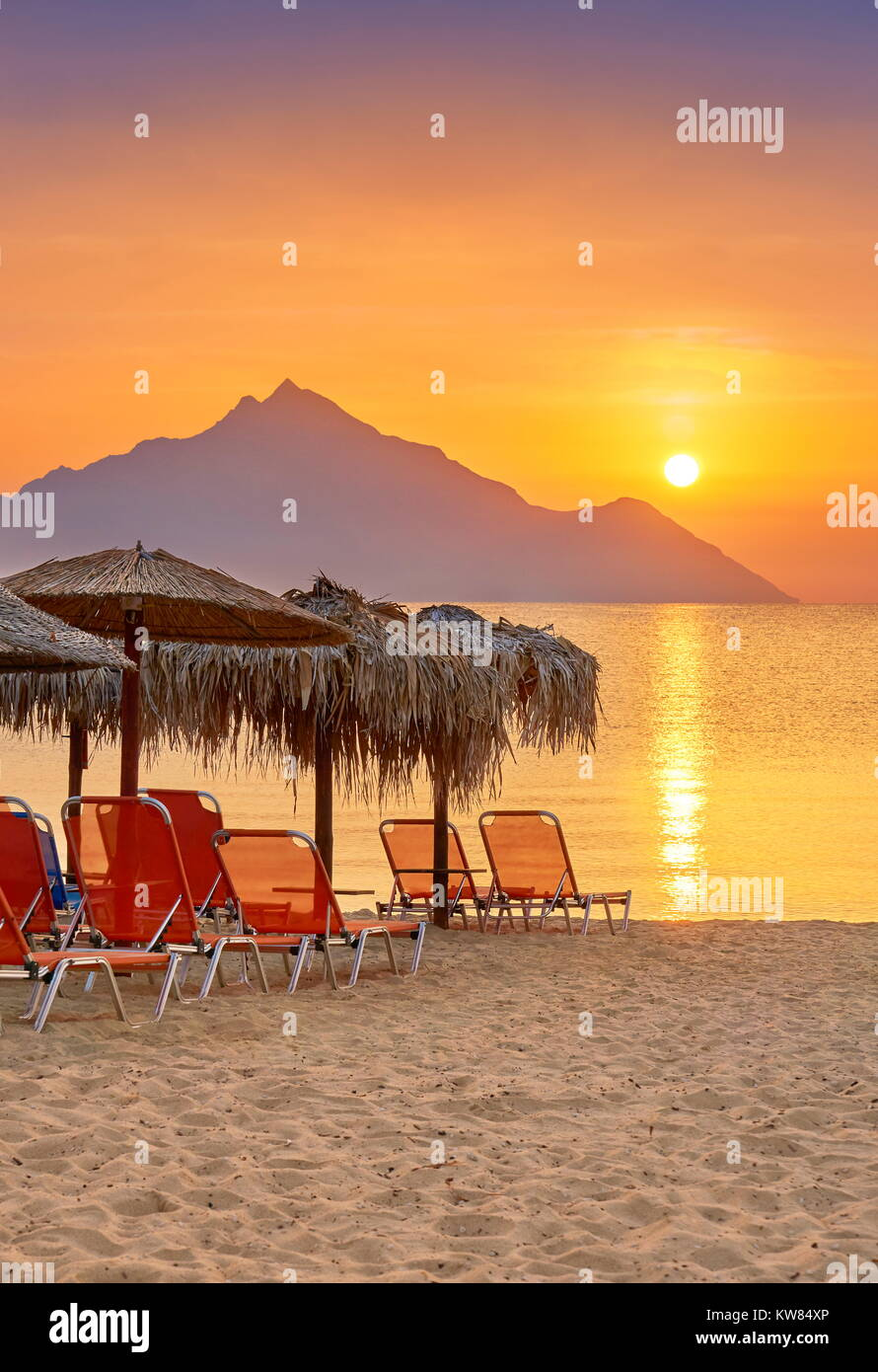 Sunrise at Halkidiki (or Chalkidiki) Beach, Mount Athos in the background, Greece - Stock Image