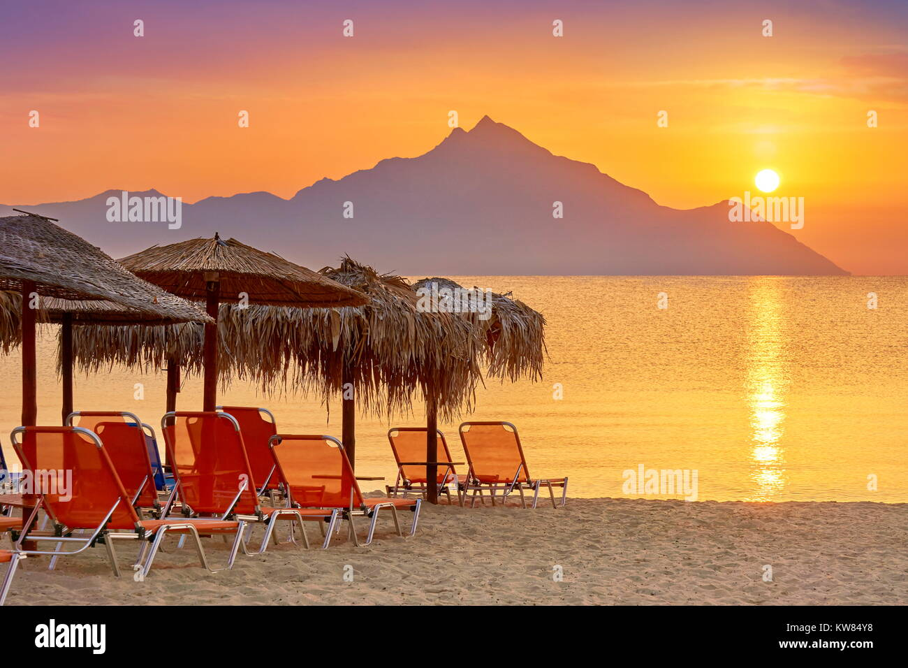 Sunrise at Halkidiki (or Chalkidiki) Beach, Mount Athos in the background, Sithonia, Greece Stock Photo
