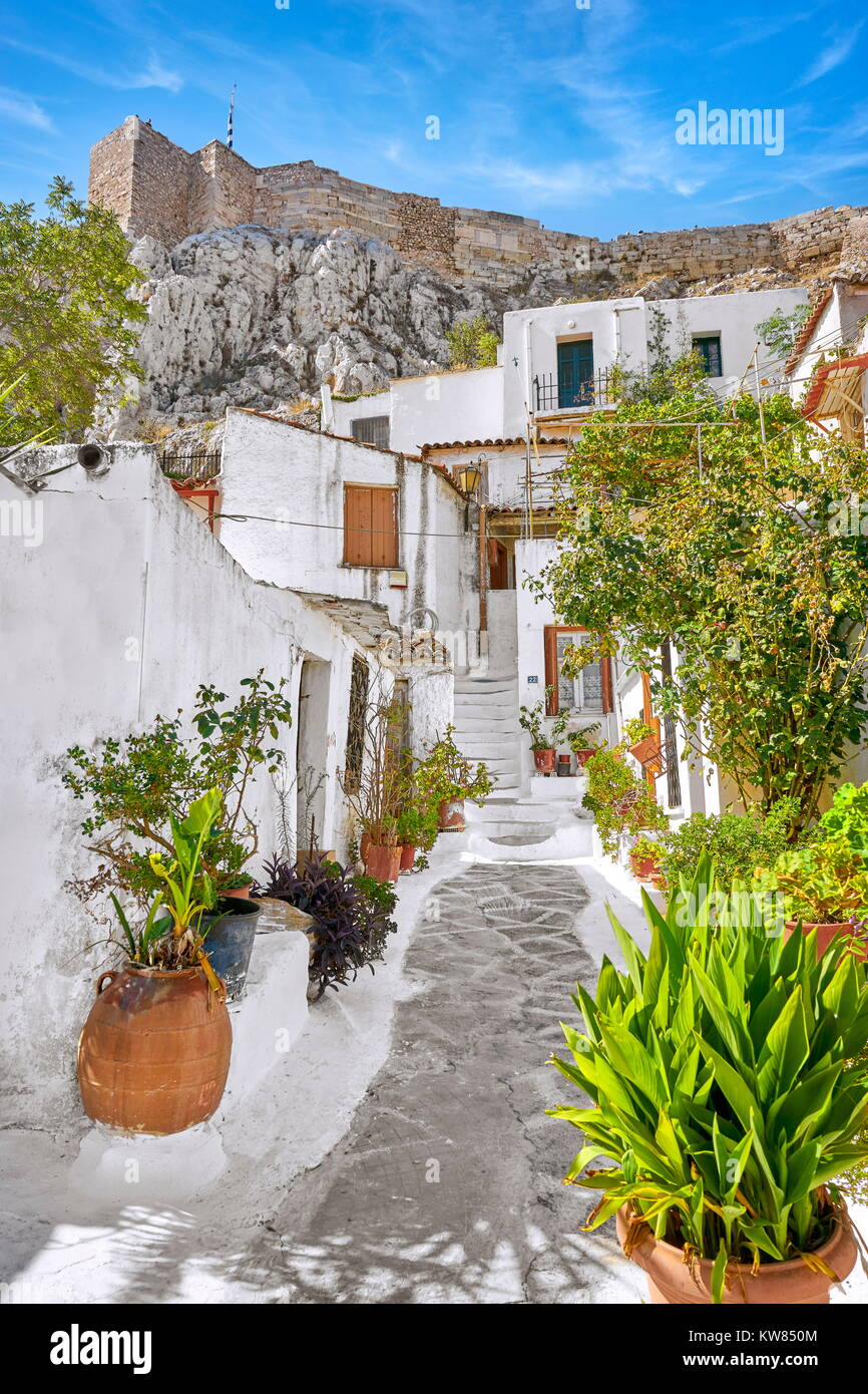 Acropolis and white houses in the Anafiotika quarter, neighborhood of Plaka, Athens, Greece - Stock Image
