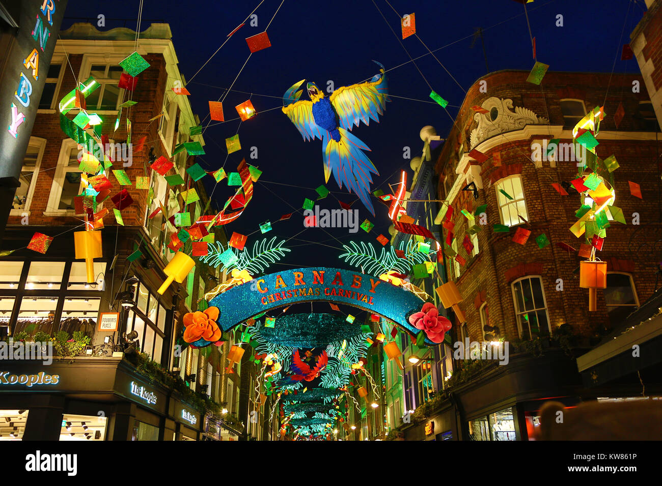 christmas lights in carnaby street london with a tropical xmas carnival theme stock image