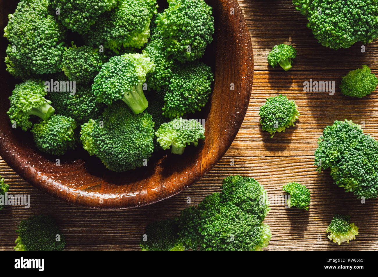 Fresh Washed Broccoli Florets on Cedar Table - Stock Image