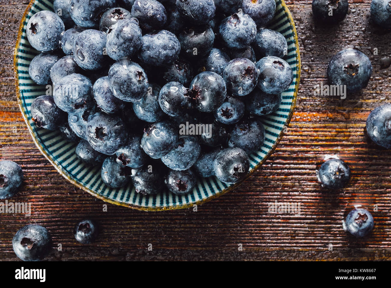 Fresh Washed Blueberries on Dark Table - Stock Image