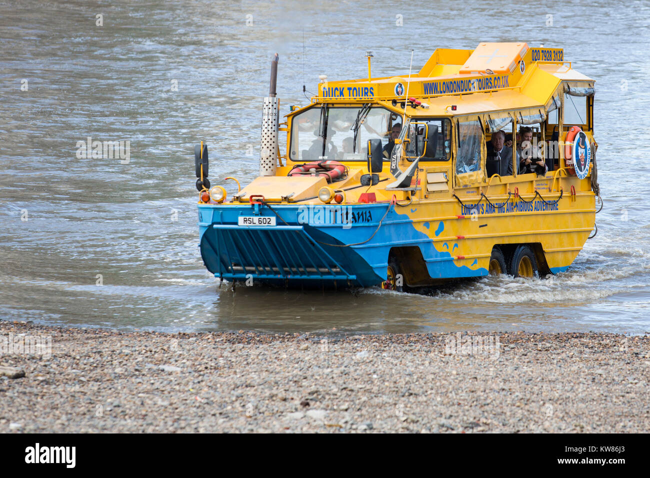London Duck Tours amphibious vehicle emerging from the River Thames, London, England, United Kingdom - Stock Image