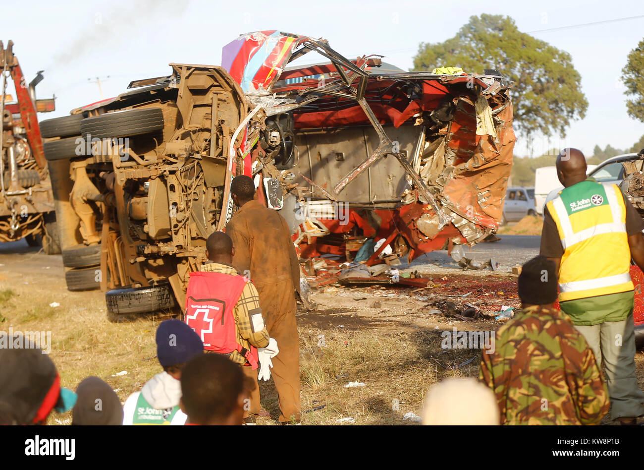 Nairobi. 31st Dec, 2017. People gather around the site where a road accident occurred on the Nakuru-Eldoret highway Stock Photo