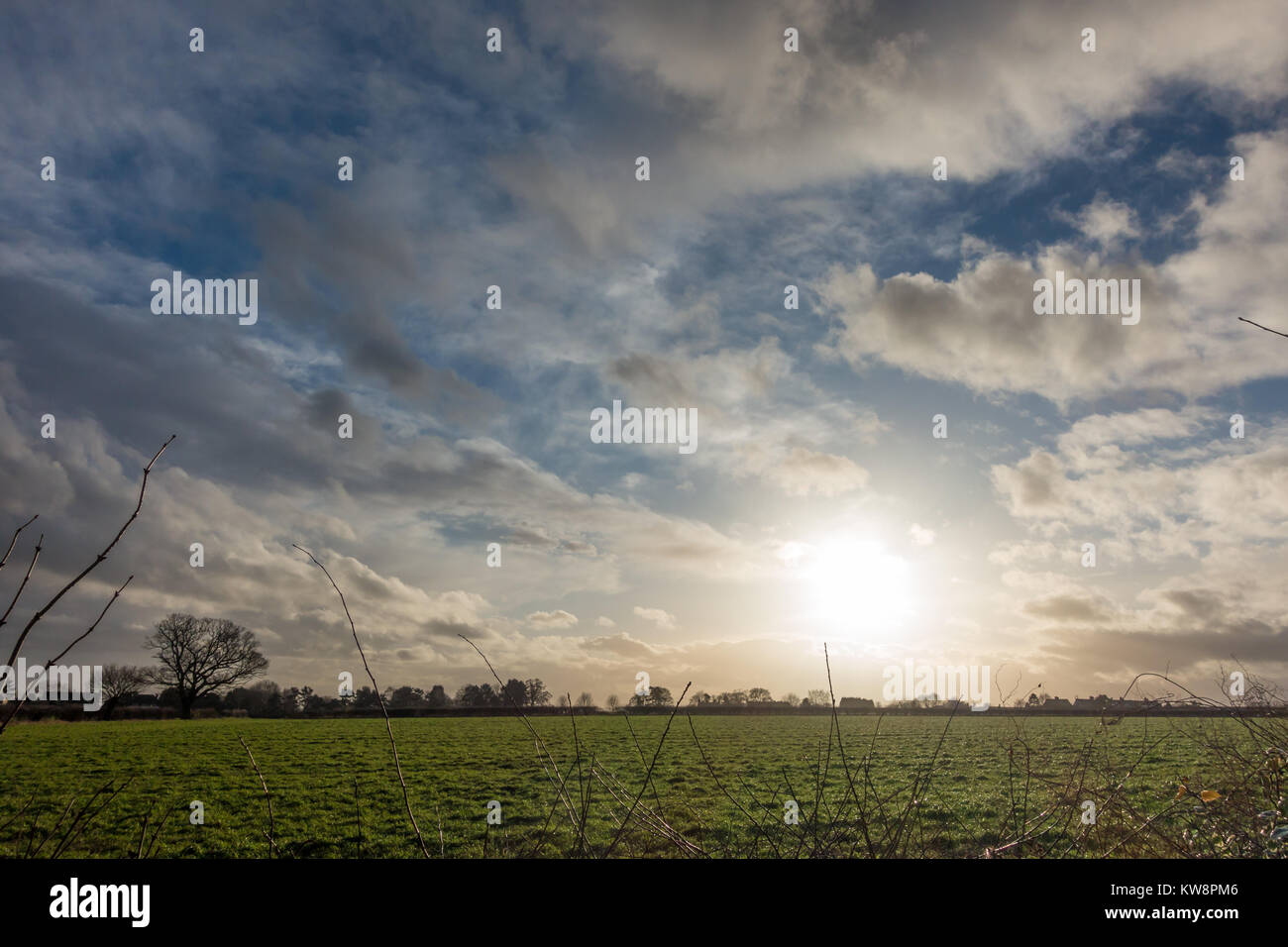 Wolverhampton, UK. 31st Dec 2017. UK Weather: The sun peaks through the clouds at the end of the day after a grey - Stock Image