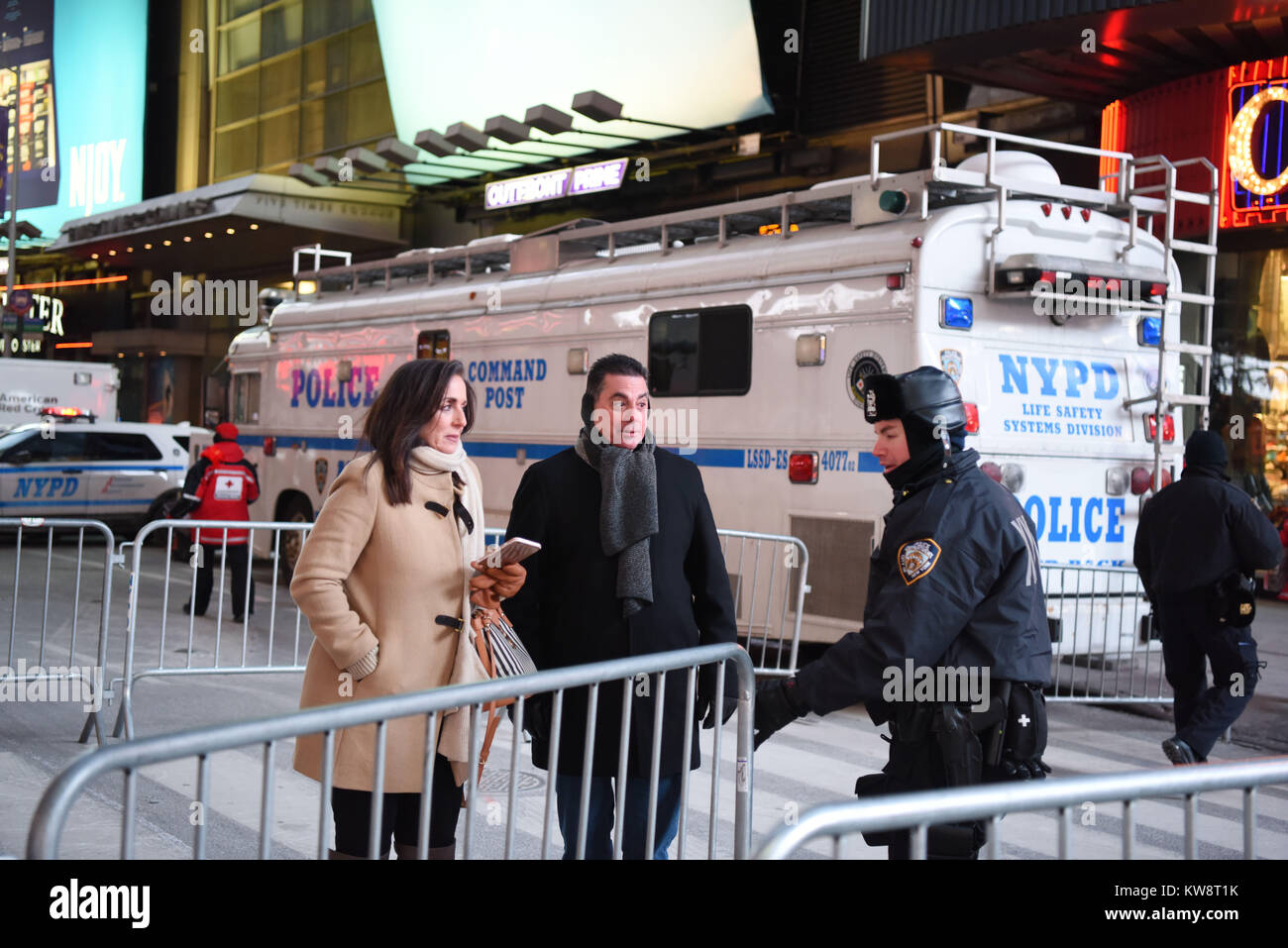 New York, USA. 31st Dec, 2017. A policeman requires fro identity cards at an entrance to Times Square in New York, - Stock Image