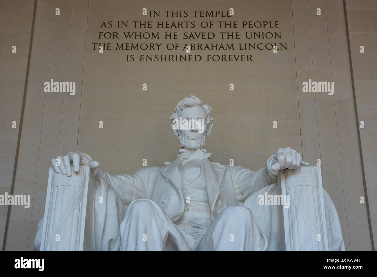 Close up interior shot of marble statue of Abraham Lincoln sitting contemplating in the Lincoln Memorial, Washington Stock Photo